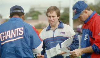 "FILE - In this Jan. 23, 1991, file photo, New York Giants defensive coordinator Bill Belichick, center, goes over the defensive game plan with other coaches as they prepare for Super Bowl 25 against the Buffalo Bills, in Tampa, Fla. The Giants defeated the Bills 20-19 in Super Bowl 25 on Jan. 25, 1991. The top ""D"" almost always prevails against the top ""O,"" going 5-1 so far when those teams meet to determine a champion _ even though each offense was led by a quarterback who is in the Pro Football Hall of Fame (or, in the most recent case, is expected to be). (AP Photo/File)"