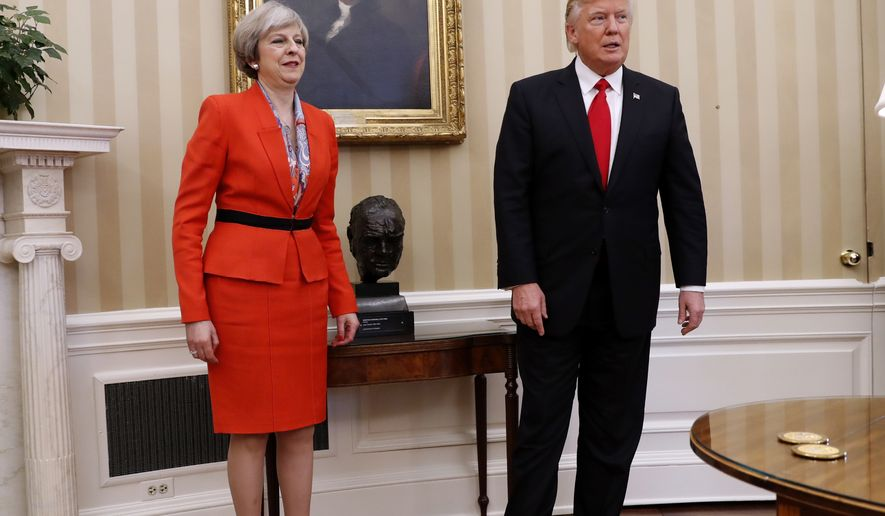 President Donald Trump and British Prime Minister Theresa May, Friday, Jan. 27, 2017, stand in the Oval Office of the White House in Washington.  (AP Photo/Pablo Martinez Monsivais)