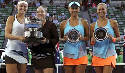 Lucie Safarova, left, of the Czech Republic and partner Bethanie Mattek-Sands, second from left, of the U.S. pose with their trophy after defeating Andrea Hlavackova , right, of the Czech Republic and Peng Shuai of China in the women's doubles final at the Australian Open tennis championships in Melbourne, Australia, Friday, Jan. 27, 2017.(AP Photo/Aaron Favila)