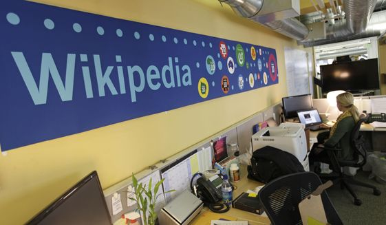 In this  Jan. 18, 2012, file photo, Mallory Whitt works at her desk at the offices of the Wikipedia Foundation in San Francisco. (AP Photo/Eric Risberg, File)