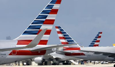 FILE - In this May 27, 2015, file photo, American Airlines jets taxi at Miami International Airport, in Miami. American Airlines Group Inc. reports quarterly financial results Friday, Jan. 27, 2017. (AP Photo/Lynne Sladky, File)