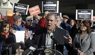 Sen. Jeff Merkley, D-Ore., speaks to a crowd during a rally in Portland, Ore., Friday, Jan. 27, 2017. Several hundred supporters gathered with Oregon congressional leaders in protest against Education Secretary nominee Betsy DeVos. (AP Photo/Don Ryan) ** FILE **
