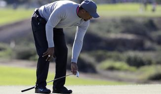 Tiger Woods reacts after missing a birdie putt on 13th hole of the north course during the second round of the Farmers Insurance Open golf tournament Friday, Jan. 27, 2017, at Torrey Pines Golf Course in San Diego. (AP Photo/Gregory Bull)