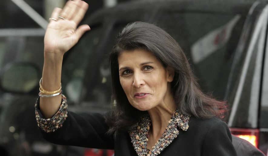 The new United States Ambassador to the United Nations Nikki Haley waves to reporters as she arrives to the home of the U.S. Mission in New York, Thursday, Jan. 26, 2017. (AP Photo/Seth Wenig)