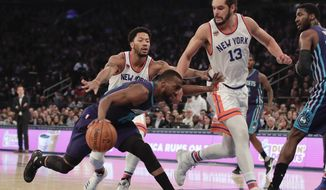 Charlotte Hornets guard Kemba Walker (15) drives against New York Knicks center Joakim Noah (13) and guard Derrick Rose during the first quarter of an NBA basketball game, Friday, Jan. 27, 2017, in New York. (AP Photo/Julie Jacobson)