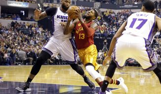 Indiana Pacers forward Paul George (13) is fouled as he drives on Sacramento Kings forward DeMarcus Cousins (15) during the first half of an NBA basketball game in Indianapolis, Friday, Jan. 27, 2017. (AP Photo/Michael Conroy)