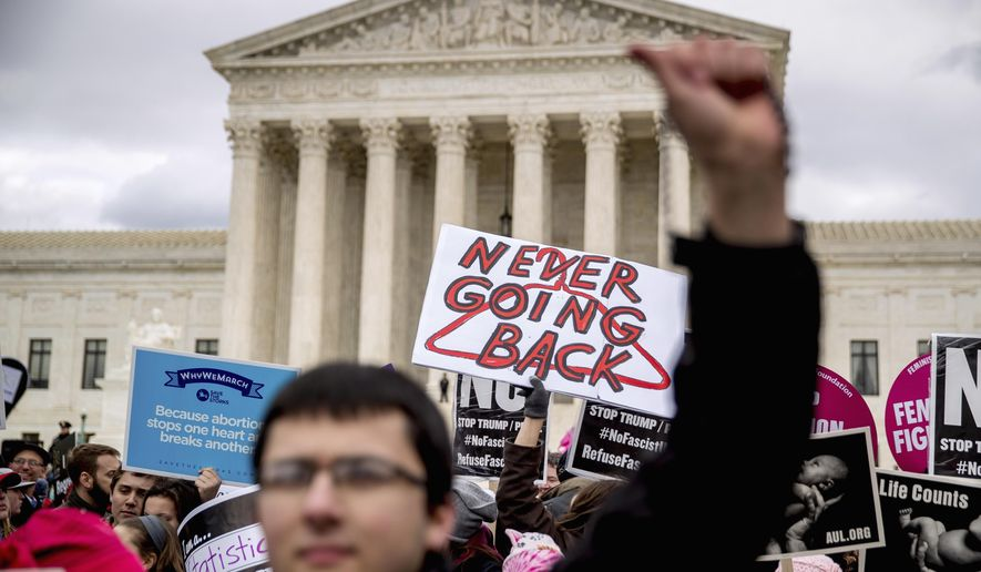 Pro-life and anti-abortion activists converge in front of the Supreme Court in Washington, Friday, Jan. 27, 2017, during the annual March for Life. Thousands of anti-abortion demonstrators gathered in Washington for an annual march to protest the Supreme Court's landmark 1973 decision that declared a constitutional right to abortion. (AP Photo/Andrew Harnik)