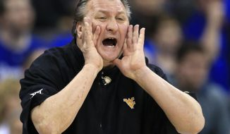 FILE - In this March 11, 2016, file photo, West Virginia head coach Bob Huggins yells to his team during the first half of an NCAA college basketball game against Oklahoma in the semifinals of the Big 12 conference tournament in Kansas City, Mo. The SEC/Big 12 Challenge gives members of each league an opportunity to gain some national attention the weekend before the Super Bowl. But some coaches would rather not have this type of event taking place in the middle of their conference schedules. (AP Photo/Orlin Wagner, File)