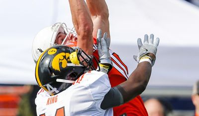 Wide receiver Cooper Kupp of Eastern Washington (10) catches a pass over cornerback Desmond King of Iowa (14) during practice for Saturday's Senior Bowl college football game, Wednesday, Jan. 25, 2017, in Mobile, Ala. (AP Photo/Butch Dill)