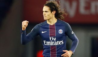 FILE- In this Sunday, Nov. 6, 2016 file photo, PSG's Edinson Cavani reacts after their first goal during their French League One soccer match between PSG and Marseille at the Parc des Princes stadium in Paris, France. Sunday's table-topping clash between defending champion Paris Saint-Germain and league leader Monaco pits two of the league's most feared strikers against each other. (AP Photo/Francois Mori, File)