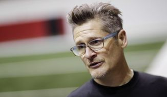 Atlanta Falcons general manager Thomas Dimitroff answers questions from the media at the NFL football team's practice facility in Flowery Branch, Ga., Friday, Jan. 27, 2017. Dimitroff is revisiting his past in New England's front office as Atlanta prepares to play the Patriots in the Super Bowl. For Dimitroff, this Super Bowl season has re-established his reputation as a GM who can build a winner. (AP Photo/David Goldman)