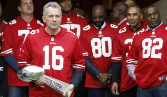FILE - In this Dec. 20, 2015, file photo, former San Francisco 49ers quarterback Joe Montana (16) carries a Super Bowl trophy as he and other former players are introduced for a halftime ceremony during an NFL football game between the 49ers and the Cincinnati Bengals in Santa Clara, Calif. Montana remembers what it was like to start his first Super Bowl. Montana was in his third season with the 49ers, when they faced the Cincinnati Bengals in the Pontiac Superdome. (AP Photo/Tony Avelar, File)