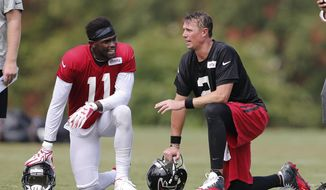 In this Aug. 9, 2016, file photo, Atlanta Falcons wide receiver Julio Jones (11) and Atlanta Falcons quarterback Matt Ryan (2) talk during an NFL football training camp practice in Flowery Branch, Ga. Atlanta led the NFL in points (540) by a wide margin, thanks to a career year from QB Matt Ryan (2), who along with WR Julio Jones (11) are All-Pros. The Falcons (13-5) take on the New England Patriots (16-2) in Super Bowl LI in Houston on Feb. 5, 2017.  (AP Photo/John Bazemore)