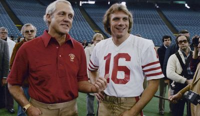 FILE - In this Jan. 19, 1982, file photo, San Francisco 49ers quarterback Joe Montana (16), and coach Bill Walsh are shown prior top Super Bowl 16 against the Cincinnati Bengals, in Pontiac, Mich. Montana remembers what it was like to start his first Super Bowl. Montana was in his third season with the San Francisco 49ers, when they faced the Cincinnati Bengals in the Pontiac Superdome. (AP Photo/Atkins, File)
