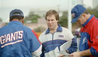 "FILE - In this Jan. 23, 1991, file photo, New York Giants defensive coordinator Bill Belichick, center, goes over the defensive game plan with other coaches as they prepare for Super Bowl 25 against the Buffalo Bills, in Tampa, Fla. The Giants defeated the Bills 20-19 in Super Bowl 25 on Jan. 25, 1991. The top ""D"" almost always prevails against the top ""O,"" going 5-1 so far when those teams meet to determine a champion _ even though each offense was led by a quarterback who is in the Pro Football Hall of Fame (or, in the most recent case, is expected to be). (AP Photo/File) **FILE**"