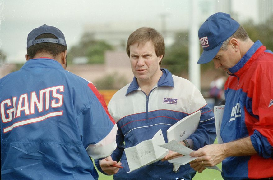 """FILE - In this Jan. 23, 1991, file photo, New York Giants defensive coordinator Bill Belichick, center, goes over the defensive game plan with other coaches as they prepare for Super Bowl 25 against the Buffalo Bills, in Tampa, Fla. The Giants defeated the Bills 20-19 in Super Bowl 25 on Jan. 25, 1991. The top """"D"""" almost always prevails against the top """"O,"""" going 5-1 so far when those teams meet to determine a champion _ even though each offense was led by a quarterback who is in the Pro Football Hall of Fame (or, in the most recent case, is expected to be). (AP Photo/File) **FILE**"""