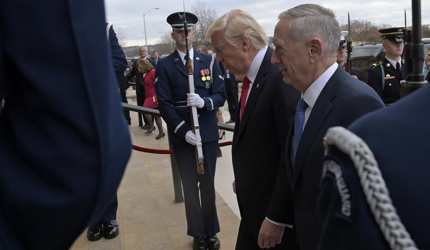 Defense Secretary James Mattis (right) was caught off guard by President Trump's Twitter announcement on July 26 that the military would renew its ban on transgender troops. (Associated Press/File)