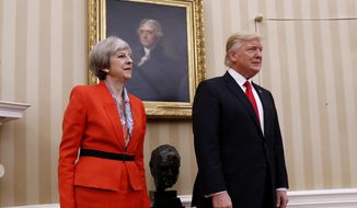President Donald Trump stands with British Prime Minister Theresa May, Friday, Jan. 27, 2017, in the Oval Office of the White House in Washington.  (AP Photo/Pablo Martinez Monsivais)