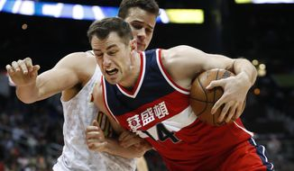 Washington Wizards forward Jason Smith (14) drives against Atlanta Hawks forward Kris Humphries during the second half of an NBA basketball game Friday, Jan. 27, 2017, in Atlanta. Washington won 112-86. (AP Photo/John Bazemore)
