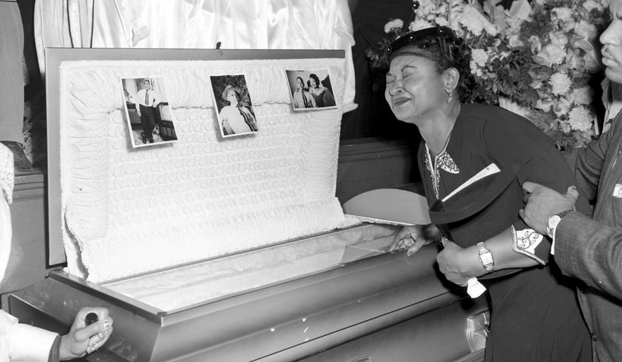 In this Sept. 6, 1955 file photo, Mamie Till Mobley weeps at her son's funeral  in Chicago.  The woman at the center of the trial of Emmett Till's alleged killers has acknowledged that she falsely testified he made physical and verbal threats, according to a new book. Historian Timothy B. Tyson told The Associated Press on Saturday, Jan. 28, 2017,  that Carolyn Donham broke her long public silence in an interview with him in 2008. (AP Photo/Chicago Sun-Times)   /Chicago Sun-Times via AP) **FILE**