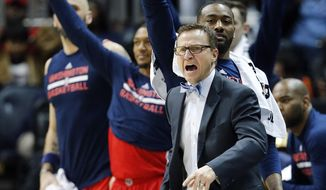Washington Wizards coach Scott Brooks and players react after a Wizards 3-point basket against the Atlanta Hawks during the second half of an NBA basketball game Friday, Jan. 27, 2017, in Atlanta. Washington won 112-86. (AP Photo/John Bazemore)