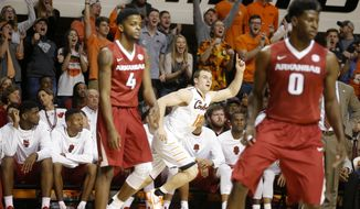 Oklahoma State's Phil Forte III (13) gestures after making a 3-pointer during an NCAA college basketball game against Arkansas at Gallagher-Iba Arena in Stillwater, Okla., Saturday, Jan. 28, 2017. (Bryan Terry/The Oklahoman via AP)
