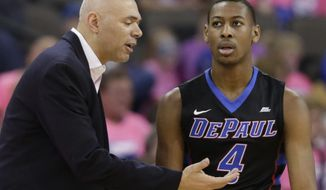DePaul coach Dave Leitao talks to Brandon Cyrus (4) during the first half of an NCAA college basketball game against Creighton in Omaha, Neb., Saturday, Jan. 28, 2017. (AP Photo/Nati Harnik)