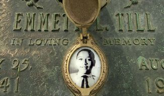 In this May 4, 2005, file photo, Emmett Till's photo is seen on his grave marker in Alsip, Ill. (Robert A. Davis/Chicago Sun-Times via AP) ** FILE **