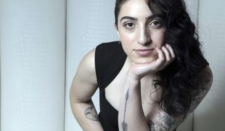 This photo taken Jan. 20, 2017, in Miami shows Emily Estefan. The daughter of Gloria & Emilio releases her debut album on Feb. 3, 2017, a day after her Festival Miami performance. Emily wrote a song featured in her parents' Broadway musical, On Your Feet, and has her own, edgier, contemporary sound. (José A. Iglesias/El Nuevo Herald via AP)