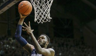 Georgetown center Jessie Govan (15) goes to the basket in front of Butler forward Kelan Martin (30) during the second half of an NCAA college basketball game in Indianapolis, Saturday, Jan. 28, 2017. Georgetown won 85-81. (AP Photo/AJ Mast) **FILE**