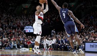 Portland Trail Blazers guard Damian Lillard, left, shoots a 3-point basket in front of Memphis Grizzlies guard Tony Allen during the second half of an NBA basketball game in Portland, Ore., Friday, Jan. 27, 2017. The Trail Blazers won 112-109. (AP Photo/Craig Mitchelldyer)