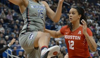 Connecticut's Gabby Williams keeps the ball from Houston's Brianne Coffman, right, in the half of an NCAA college basketball game, Saturday, Jan. 28, 2017, in Hartford, Conn. (AP Photo/Jessica Hill)