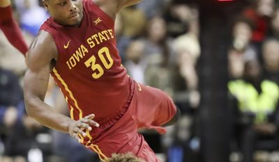 Iowa State guard Deonte Burton (30) collides with Vanderbilt guard Matthew Fisher-Davis in the second half of an NCAA college basketball game Saturday, Jan. 28, 2017, in Nashville, Tenn. (AP Photo/Mark Humphrey)