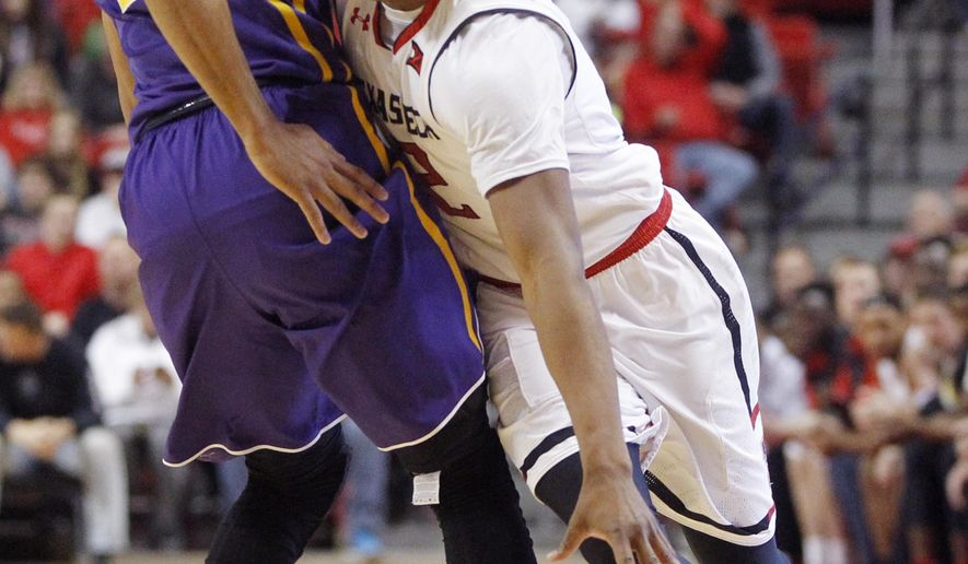 Texas Tech guard Devon Thomas drives around Louisiana State guard Jalyn Patterson during the first period during an NCAA college basketball game  Saturday, Jan. 28, 2017, at United Supermarkets Arena in Lubbock, Texas. (Mark Rogers/Lubbock Avalanche-Journal via AP)