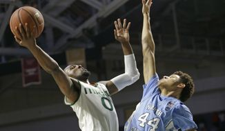 Miami guard Ja'Quan Newton (0) goes to the basket as North Carolina forward Justin Jackson (44) defends in the first half of an NCAA college basketball game, Saturday, Jan. 28, 2017, in Coral Gables, Fla. (AP Photo/Alan Diaz)