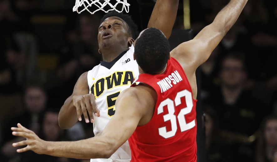 Iowa forward Tyler Cook shoots over Ohio State center Trevor Thompson (32) during the first half of an NCAA college basketball game, Saturday, Jan. 28, 2017, in Iowa City, Iowa. (AP Photo/Charlie Neibergall)