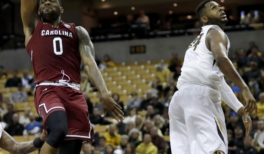 South Carolina's Sindarius Thornwell (0) heads to the basket past Missouri's Kevin Puryear during the second half of an NCAA college basketball game Saturday, Jan. 28, 2017, in Columbia, Mo. (AP Photo/Jeff Roberson)