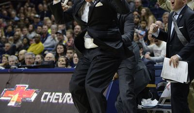 Tulane coach MikeDunleavy reacts to a call against his team during the second half of an NCAA college basketball game against Connecticut, Saturday, Jan. 28, 2017, in Storrs, Conn. (AP Photo/Jessica Hill)