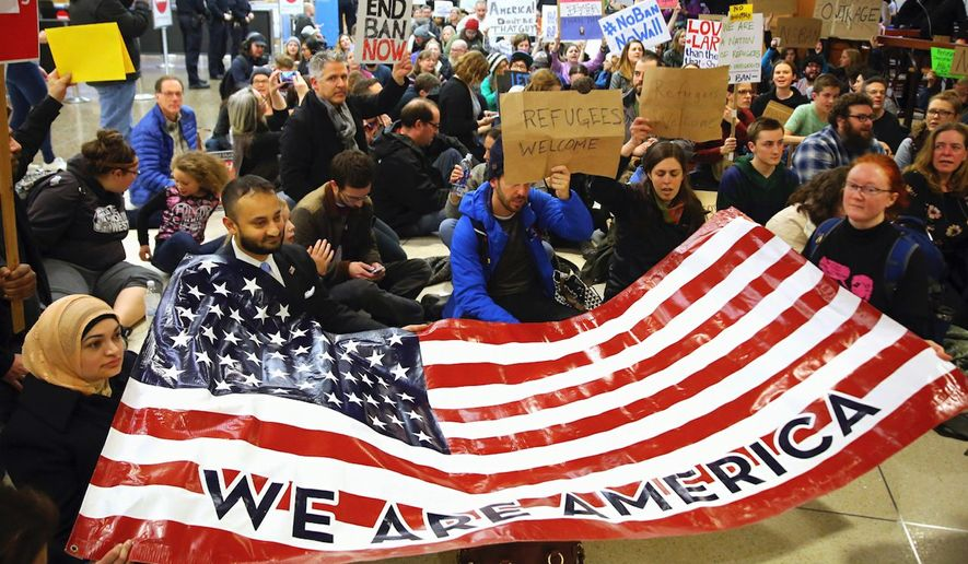 Protesters gather at the Seattle-Tacoma International Airport to protest President Trump's new immigration restrictions. (Associated Press)