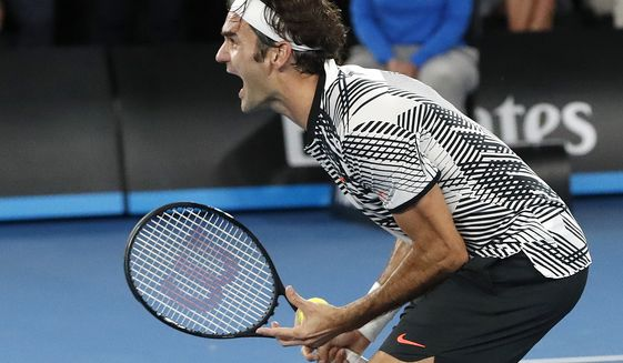 Switzerland's Roger Federer celebrates after defeating Spain's Rafael Nadal in the men's singles final at the Australian Open tennis championships in Melbourne, Australia, Sunday, Jan. 29, 2017. (AP Photo/Dita Alangkara)