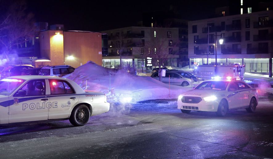 "Police survey the scene after deadly shooting at a mosque in Quebec City, Canada, Sunday, Jan. 29, 2017. Quebec Premier Philippe Couillard termed the act ""barbaric violence"" and expressed solidarity with victims' families. (Francis Vachon/The Canadian Press via AP)"