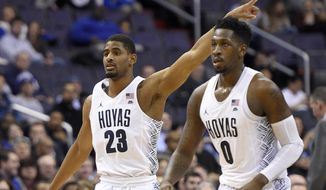 Georgetown guard Rodney Pryor (23) points next to L.J. Peak (0) during the second half of an NCAA college basketball game against Creighton, Wednesday, Jan. 25, 2017, in Washington. Georgetown won 71-51. (AP Photo/Nick Wass)