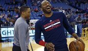 New Orleans Pelicans guard Tim Frazier, left, and Washington Wizards guard John Wall laugh together before an NBA basketball game in New Orleans, Sunday, Jan. 29, 2017. (AP Photo/Max Becherer)
