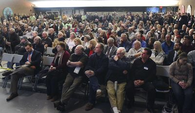 In this Tuesday, Jan. 24, 2017 photo, citizens pack a public hearing on a proposed casino in East Windsor, Conn. The Mohegan and Mashantucket Pequot tribes seek approval from the General Assembly to build a jointly owned casino in either East Windsor or Windsor Locks to help compete with the MGM Resorts International casino under construction in Springfield, Mass. (Jim Michaud/Journal Inquirer via AP)