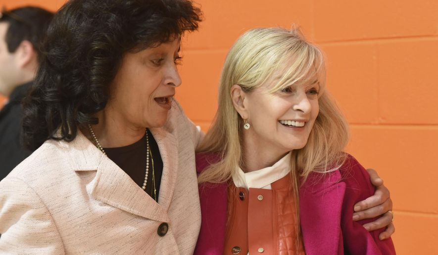 ADVANCE FOR WEEKEND EDITIONS, JAN. 28-29 - In this Wednesday, Jan. 25, 2017 photo, Chattanooga Girls Leadership Academy advocate and donor Karen Hutton, right, is embraced by Dr. Elaine Swafford at the opening of the newly renovated Hutton Gymnasium in Highland Park, Tenn. Hutton donated more than $500,00 for the project.(Tim Barber/Chattanooga Times Free Press via AP)