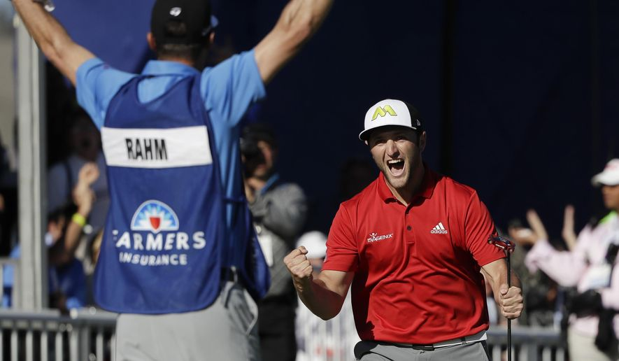 Jon Rahm, right, of Spain, reacts after making a putt for eagle on the 18th hole of the South Course during the final round of the Farmers Insurance Open golf tournament Sunday, Jan. 29, 2017, at Torrey Pines Golf Course in San Diego. (AP Photo/Gregory Bull)