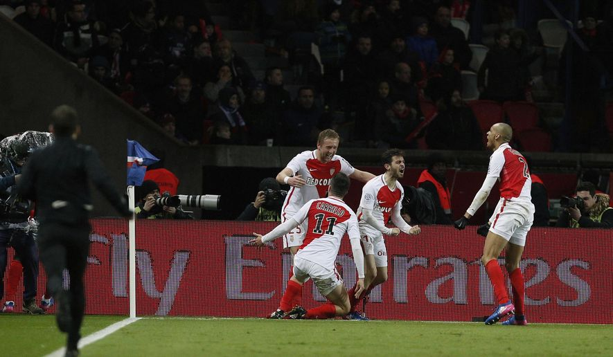 Monaco's Bernardo Silva, second right, celebrates with teammates after scoring a goal during their League One soccer match against Paris Saint Germain, at the Parc des Princes stadium, in Paris, France, Sunday, Jan. 29, 2017. (AP Photo/Thibault Camus)