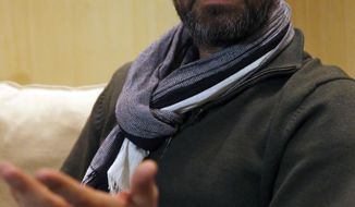 "Kinan Azmeh, 40, a Syrian musician who is one of thousands of valid US green card holders who have found their immigration status in limbo after Trump's order Friday, gives an interview to The Associated Press, in Beirut, Lebanon, Sunday, Jan. 29, 2017. Azmeh, who plays the clarinet, and is currently touring with renowned cellist Yo-Yo Ma, said he is waiting to see whether he will be allowed to return to his New York home in the wake of President Donald Trump's travel ban on seven Muslim-majority nations. Azmeh, said he does not have a ""plan B"" if he is not allowed back into the United States on his scheduled return Wednesday. (AP Photo/Hussein Malla)"