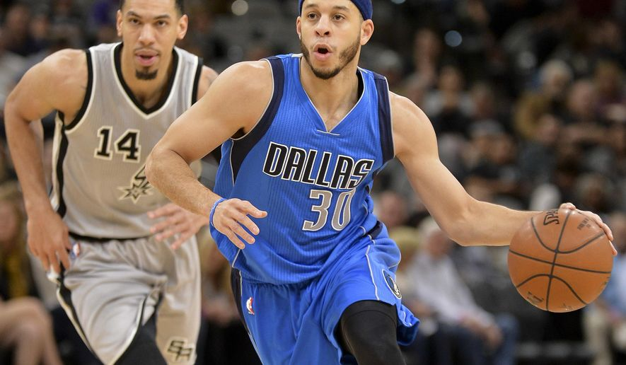 Dallas Mavericks guard Seth Curry (30) drives the lane ahead of San Antonio Spurs guard Danny Green during the first half of an NBA basketball game, Sunday, Jan. 29, 2017, in San Antonio. (AP Photo/Darren Abate)