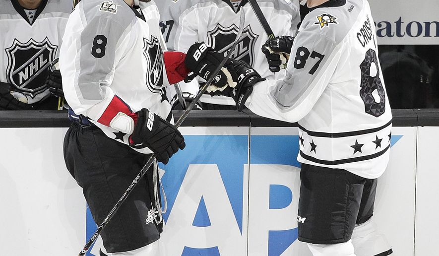 Pittsburgh Penguins's Sidney Crosby, right, of the Pittsburgh Penguins, celebrates his goal with Alex Ovechkin, of the Washington Capitals, during the NHL hockey All-Star game, Sunday, Jan. 29, 2017, in Los Angeles. (AP Photo/Jae C. Hong)
